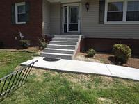 New Concrete Sidewalk and Cantilever Stairs